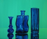 Three Blue Glass Containers on a Mirror